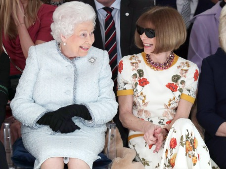 Royal visit to London Fashion Week. Queen Elizabeth II sits next to Anna Wintour (right) as they view Richard Quinn's runway show before presenting him with the inaugural Queen Elizabeth II Award for British Design as she visits London Fashion Week's BFC Show Space in central London. Picture date: Tuesday February 20, 2018. See PA story ROYAL Queen. Photo credit should read: Yui Mok/PA Wire URN:35112178